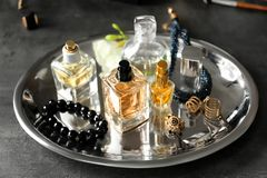 Tray with perfume bottles and accessories. On table Stock Photo