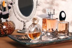 Tray with perfume bottles. On table Stock Image