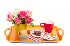 A tray with pink roses and sweets Royalty Free Stock Photo