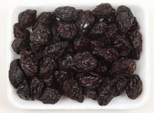 Tray of prunes from above Royalty Free Stock Photography