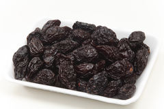 Tray of prunes Stock Photos