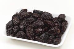 Tray of prunes Stock Photos