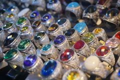 A tray of rings made of silver with gemstone. A tray of vintage rings made of silver with gemstone including sapphire, ruby, emerald, topaz etc stock photo