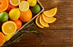 Tray with ripe citrus fruits on wooden background royalty free stock photography