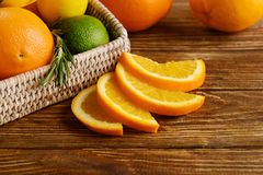 Tray with ripe citrus fruits on wooden background royalty free stock photos