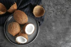 Tray with ripe coconuts. On grey background Stock Images