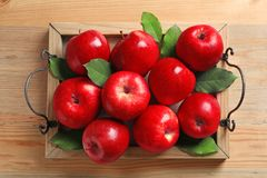Tray with ripe red apples royalty free stock photography