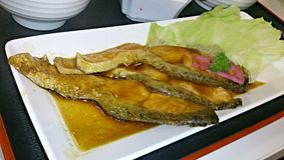 A tray of salmon teriyaki Stock Photos