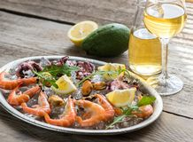 Tray with seafood. With glass of white wine Stock Photo