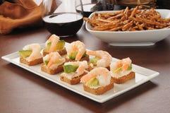 Tray of shrimp canapes. A serving tray of shrimp canapes on mini wheat toasts with avocado Royalty Free Stock Photos