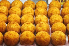 Tray of sicilian arancini. A tray full of sicilian arancini displayed in a market stall Stock Photography