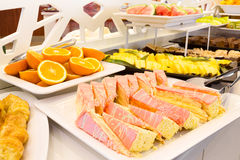 Tray of sliced cake with pink icing on a buffet Stock Photo