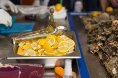 Tray of sliced fresh lemon for garnishes Stock Photo