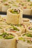 Tray of sliced pitta rolls Royalty Free Stock Photography