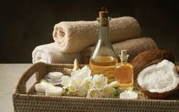 Tray with spa cosmetic, coconuts, flowers royalty free stock photography