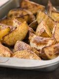 Tray of Spiced Potato Skins Royalty Free Stock Photography