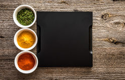 Tray with spices in bowls on both sides Royalty Free Stock Photography