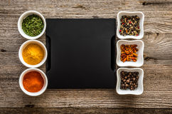 Tray with spices in bowls on both sides Stock Photography
