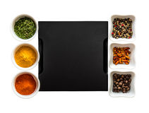Tray with spices in bowls on both sides Royalty Free Stock Photos