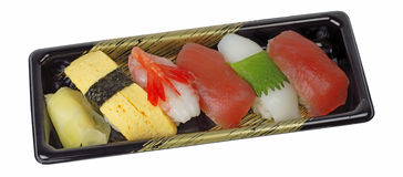 Tray with sushi. Tray with various types of sushi isolated over white background with clipping path. Very useful design element for a Japanese food restaurant Royalty Free Stock Photography