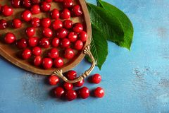 Tray with sweet cherries. On color background Stock Photos