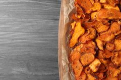 Tray with sweet potato chips on wooden table, top view. Space for text stock photography