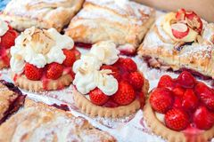 Tray of tarts. Close-up of brioches and Strawberry Shortcake Stock Photo
