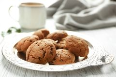 Tray with tasty homemade cookies on kitchen table. Closeup Stock Photo