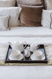 Tray of tea set on bed Royalty Free Stock Images