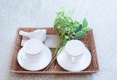 Tray with tea set and flower on the bed Stock Photography