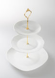 tray or three tier serving tray on a background. Stock Photography
