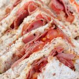Tomato and ham sandwiches. Tray of tomato and ham sandwiches Royalty Free Stock Image