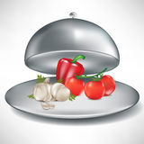 Tray with tomatoes, garlic and pepper. Open catering tray with tomatoes, garlic and pepper i Stock Photo