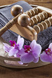 Tray with towel and orchid flowers for massage and relaxation Stock Photo
