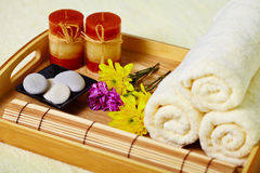 Tray of towels, candles and pebbles - spa Stock Photos