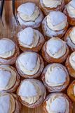Traditional Swedish Semlor or Semla Buns on wooden tray royalty free stock image