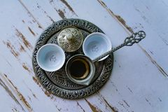 A tray with two traditional empty coffee cups. Turkish coffee kettle and Turkish delight cup together stock images