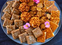 Indian sweets - Tray full of winter Diwali sweets chikki royalty free stock image