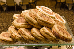 Tray of warm English muffins in serving line Stock Photography