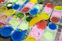 Tray of watercolour for children to learn painting.  royalty free stock photos