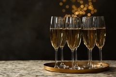 Free Tray With Glasses Of Champagne On Table Against Blurred Lights Royalty Free Stock Photography - 144847937