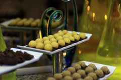 Tray with yellow ball cakes Stock Photo