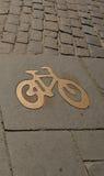 Trayectoria de la bici, en oro Fondo, textura Foto de archivo libre de regalías
