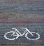 Trayectoria de la bicicleta de una piedra del mosaico Foto de archivo