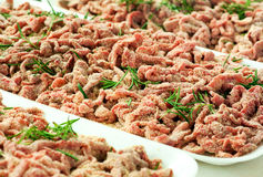 Trays of breaded strips of raw beef Royalty Free Stock Photos