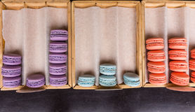 Trays of colorful French macarons Stock Images