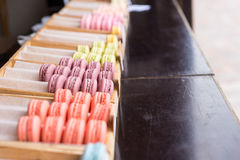 Trays filled with colorful macaroons Stock Photos