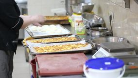 Trays with fried cheesecakes. In the kitchen, cooking for a business lunch stock footage