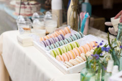 Trays of tasty french macaroons on a market Stock Photo