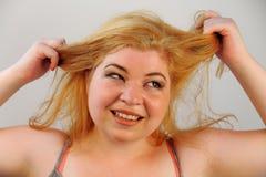 Trazione enorme dei capelli Immagini Stock